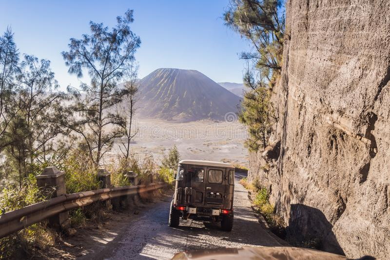 View from the inside of an offroad car riding down the road at the Bromo Tengger Semeru National Park on the Java Island. Indonesia. One of the most famous royalty free stock photography