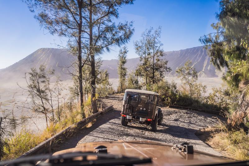 View from the inside of an offroad car riding down the road at the Bromo Tengger Semeru National Park on the Java Island. Indonesia. One of the most famous royalty free stock image