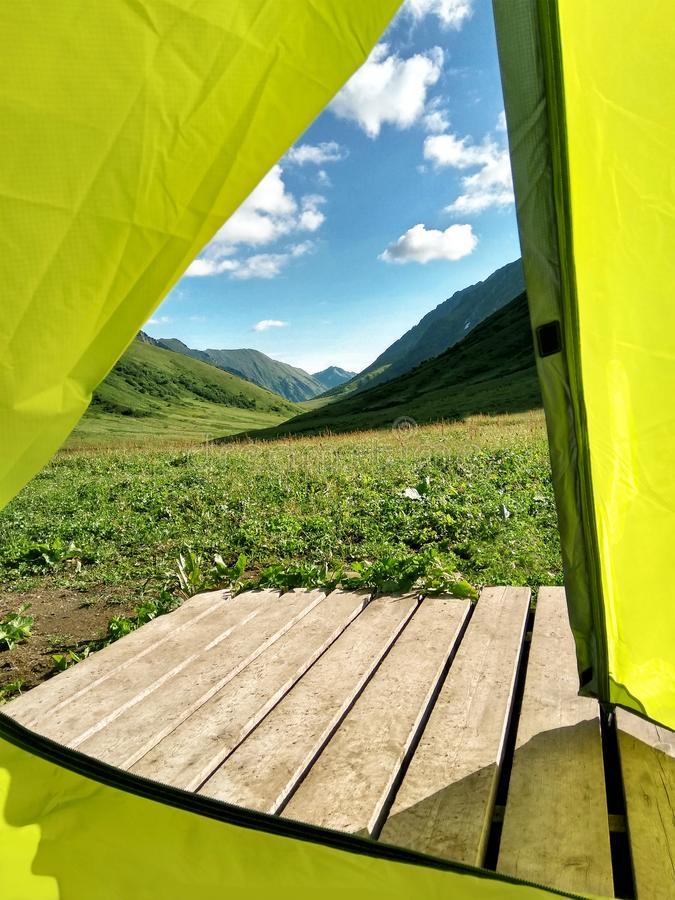 View from inside of yellow camping tent stock images