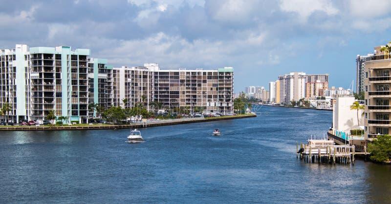 Beautiful intercoastal waterway in Hallandale Florida. View of intercoastal waterway with boats and blue water. Condominium buildings. Cloudy sky stock photos