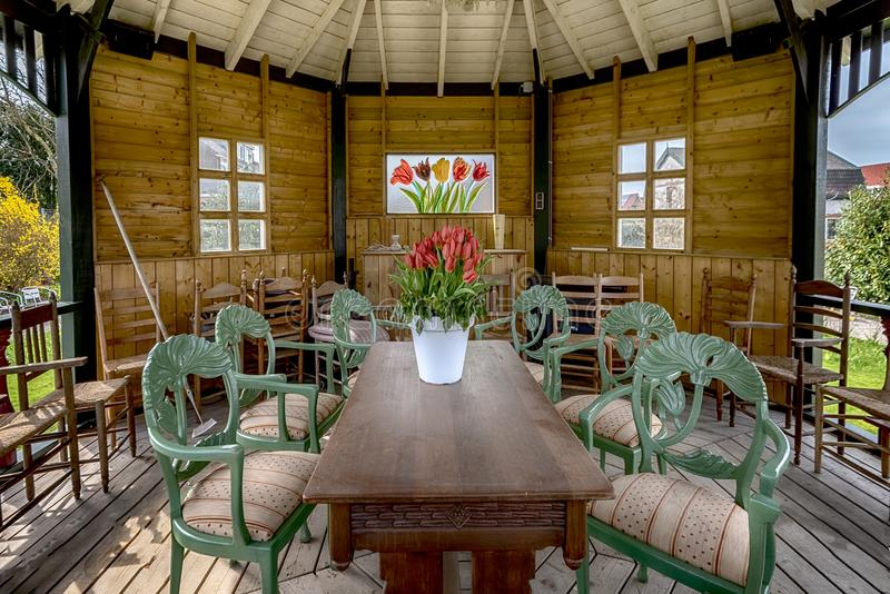 View of the interior, of a gazebo, the wooden, roof of the windows, the characteristic chairs in green royalty free stock photography