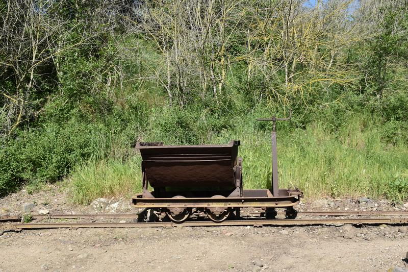 View of iron mine cart on rails. Outdoors nature storic green sky nopeople royalty free stock photos
