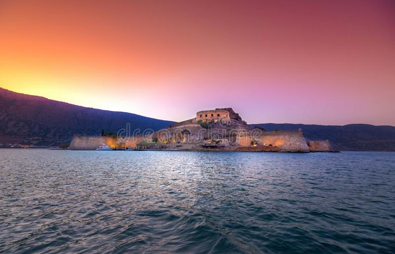 View of the island of Spinalonga with calm sea. Here were isolated lepers, humans with the Hansen`s desease, gulf of Elounda. View of the island of Spinalonga stock photo