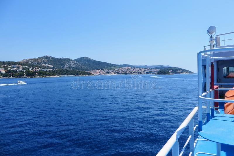 A view from the Jadrolinija ferry sailing on the adriatic sea heading towards the beautiful island and old town of Hvar, Croatia. royalty free stock images