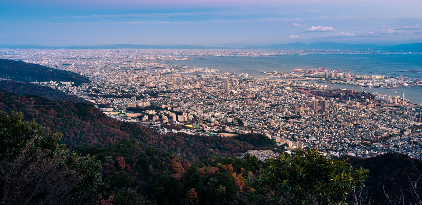 View of Japanese cities in the Kansai region from Mt. Maya. The view is designated a 'Ten Million Dollar Night View.' stock photo