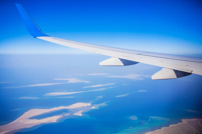 View of jet plane wing with blue sky royalty free stock photos