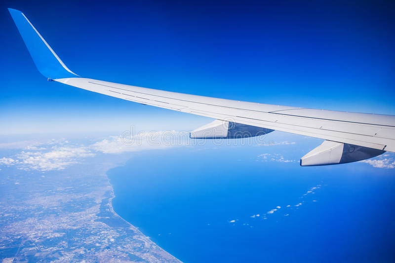 View of jet plane wing with blue sky royalty free stock images