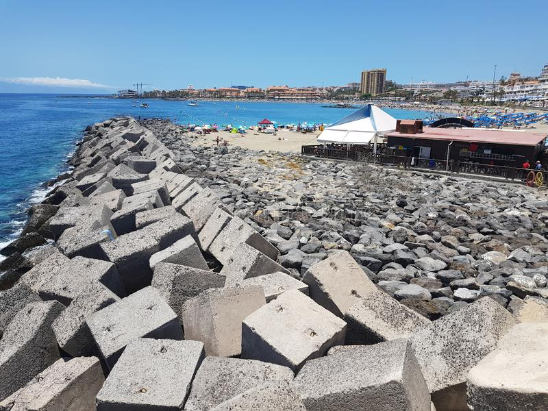 View of Jetty and concrete blocks in Las Cristiano`s Tenerife. Sea view with man made concrete cube blocks at Las Cristiano`s in Tenerife on a beautiful sunny stock photos