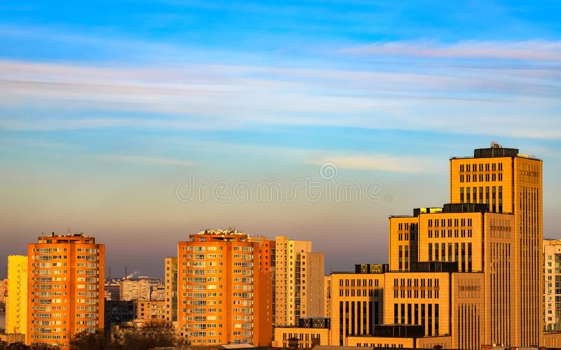 View of the Jewish cultural center Menorah, buildings, towers and skyscrapers in the Dnipro city in the evening at sunset. stock images