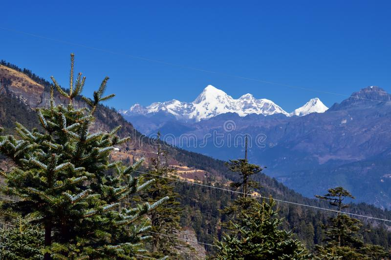 A view of Jomolhari 7326m in Bhutan through an idyllic valley royalty free stock photography