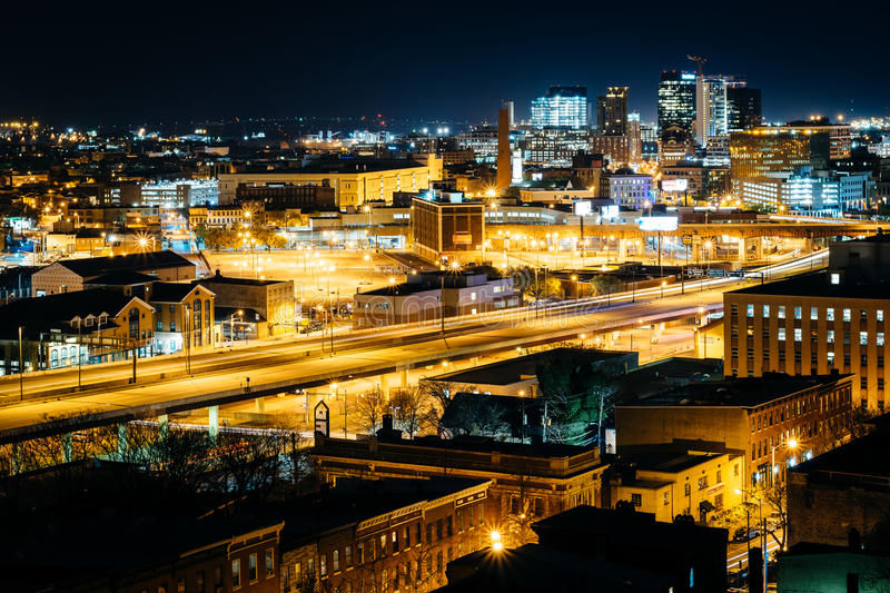 View of the Jones Falls Expressway and buildings at night, from stock image