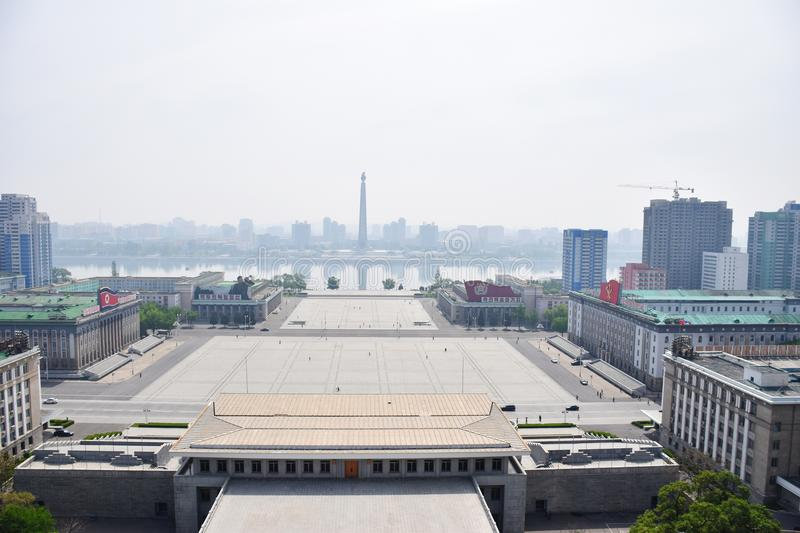 View of Juche Tower, Pyongyang, DPRK. A photograph showing the beautiful riverside view of the landmark Juche Tower by the Taedong River, in Pyongyang city of stock photo