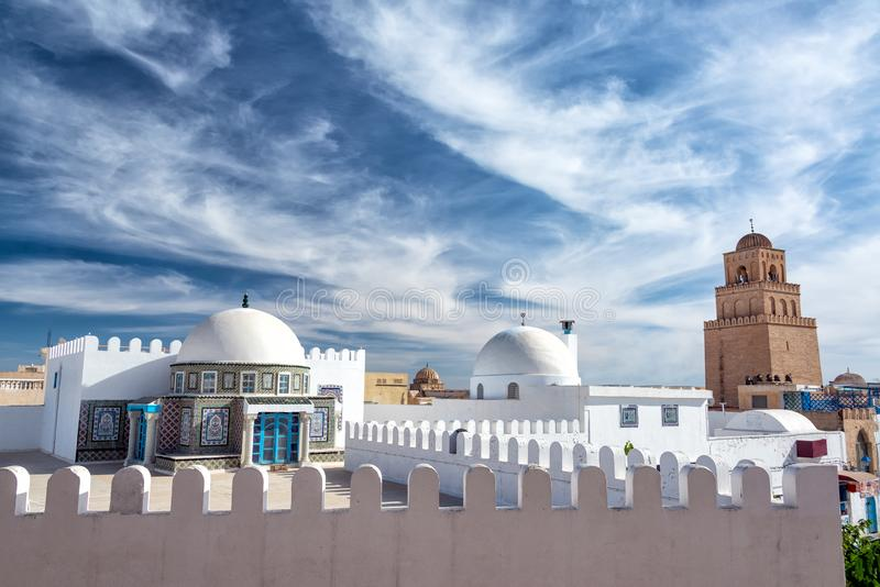 View of Kairouan, Tunisia. Dramatic looking sky with the Great Mosque in the background in Kairouan, Tunisia stock images