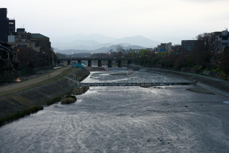 View of Kamogawa river from Shijou-Ohashi bridge just after the sunrise royalty free stock image