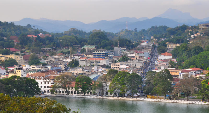 View on Kandy City, Sri Lanka. View on Kandy lake and city buildings. Kandy is home of The Temple of the Tooth Relic, one of the most sacred Buddhist places of stock photography