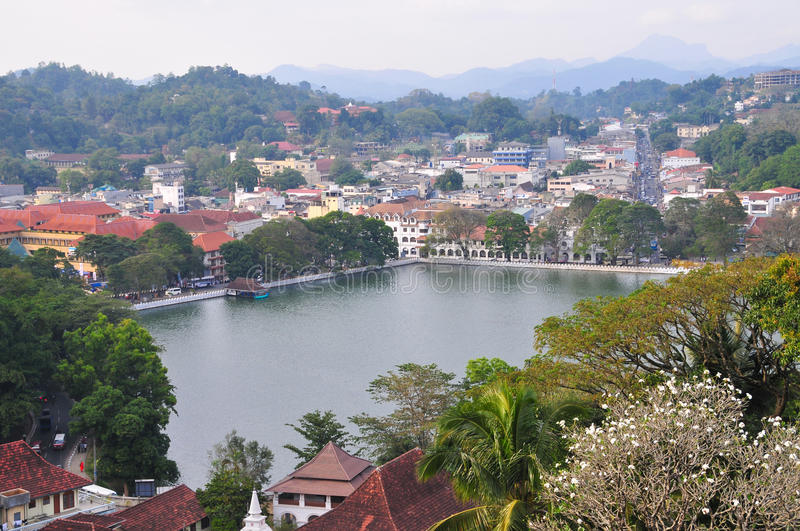View on Kandy City, Sri Lanka. View on Kandy lake and city buildings. Kandy is home of The Temple of the Tooth Relic, one of the most sacred Buddhist places of stock images