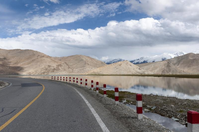 View of the Karakul Lake along the Karakoram Highway with the mountains on the background. Xinjiang, China royalty free stock photography