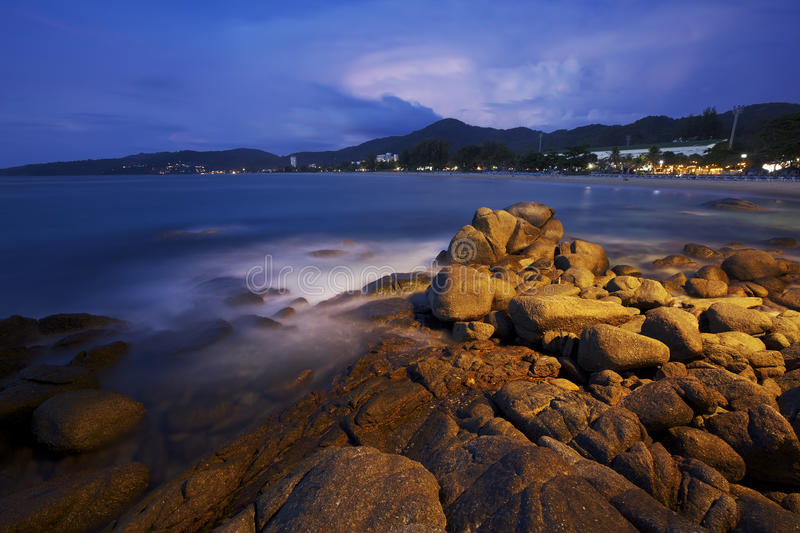 View of Karon beach at dawn. Phuket island, Thailand. Long exposure ( 2 minutes ) shot stock photography