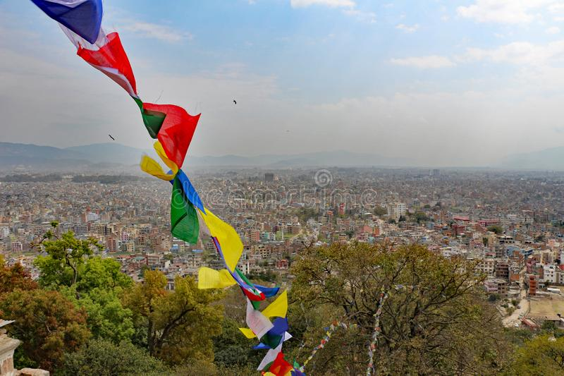 View of Kathmandu from a temple with prayer flags stock photography
