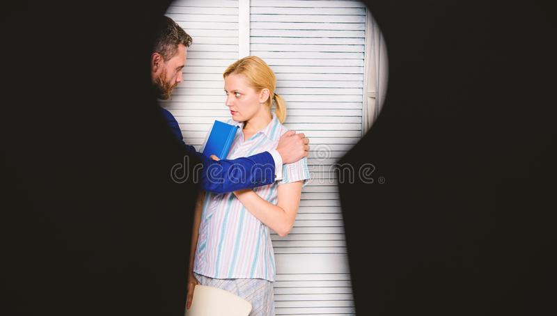 View through keyhole. Boss aggressive threatening violence. Witness of office crime. Woman suffer violence in office. Dirty secret and blackmail stock photo