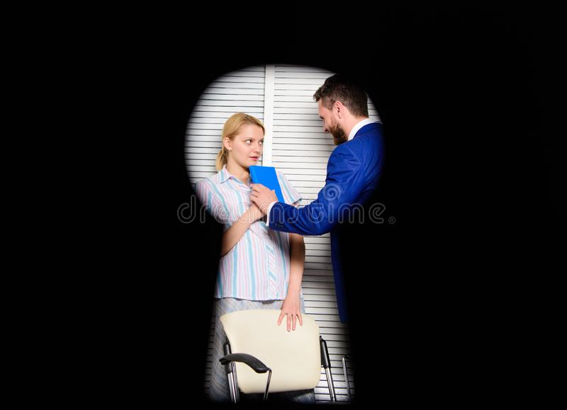 View through keyhole. Worker lady suspected in rights violation. Boss aggressive threatening. Witness of crime in office. If you are witness of rights stock photos