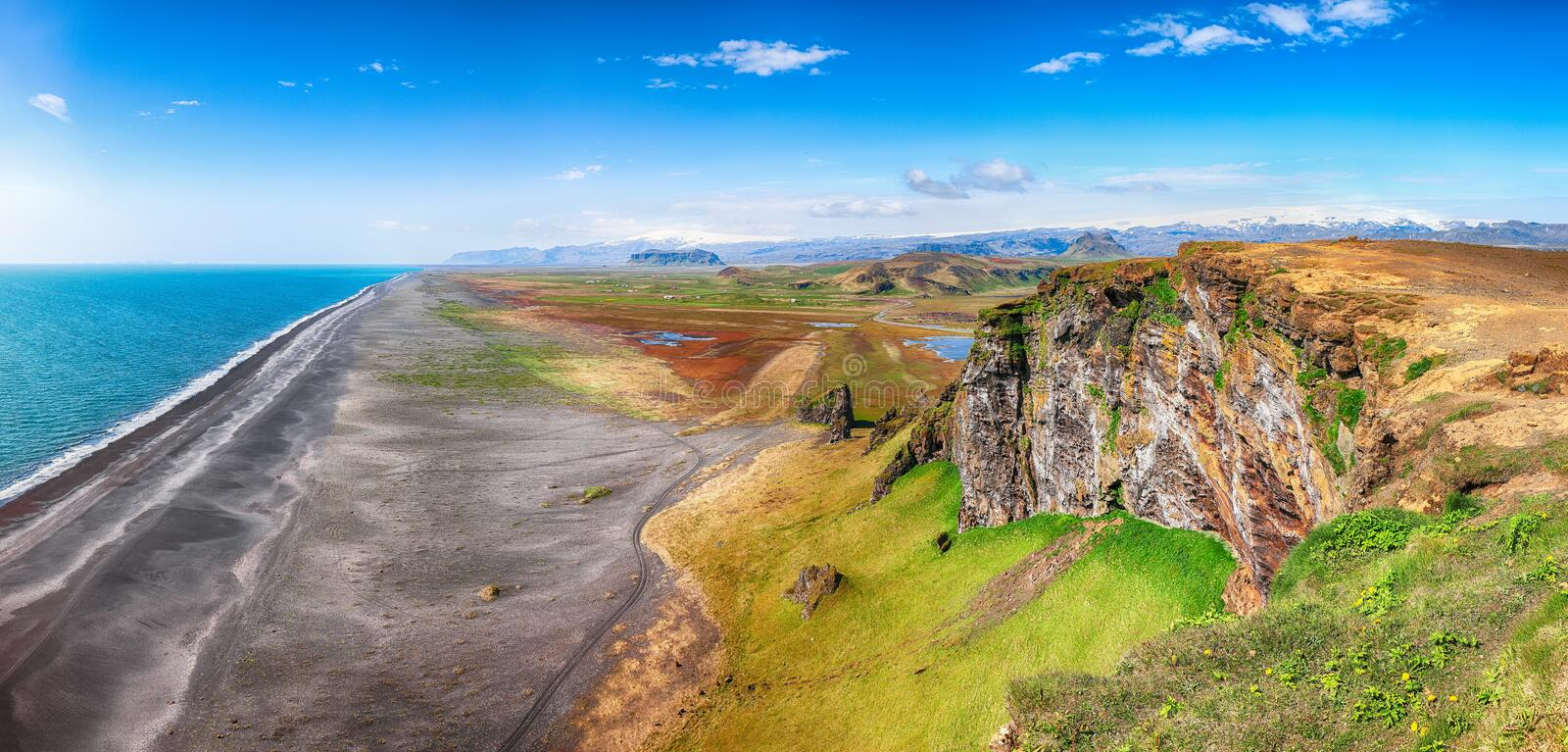 View of Kirkjufjara black sand beach from Dyrholaey promontory royalty free stock photos