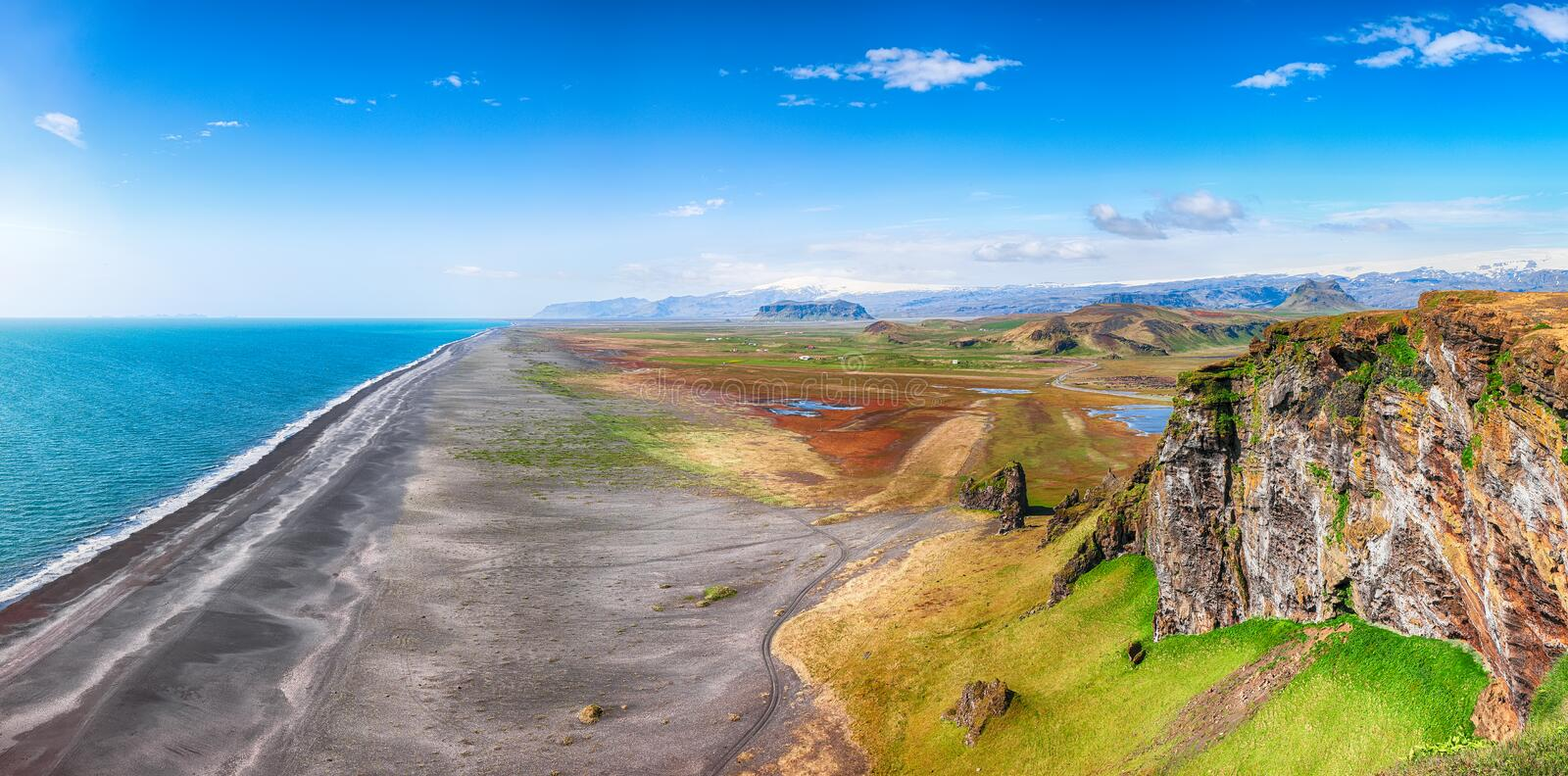 View of Kirkjufjara black sand beach from Dyrholaey promontory. On Atlantic South Coast..Location: Dyrholaey promontory, Vik I Myrdal village, Katla Geopark royalty free stock photography