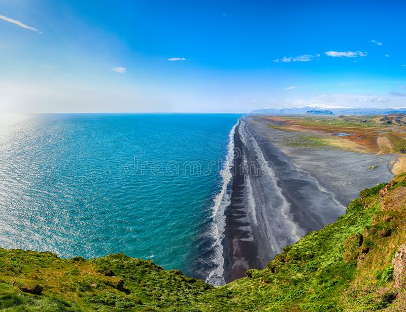 View of Kirkjufjara black sand beach from Dyrholaey promontory. On Atlantic South Coast...Location: Dyrholaey promontory, Vik I Myrdal village, Katla Geopark stock photos