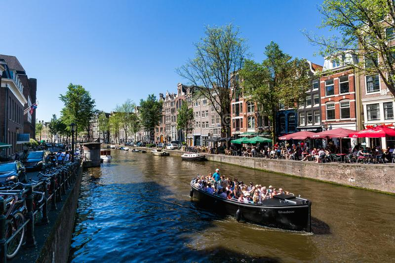 View of the Kloveniersburgwal street in the old town part of Amsterdam royalty free stock images