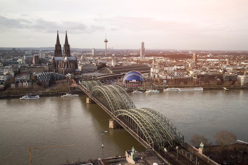 View of Koeln, Germany. Gothic cathedral and steel bridge over river Rhine royalty free stock images