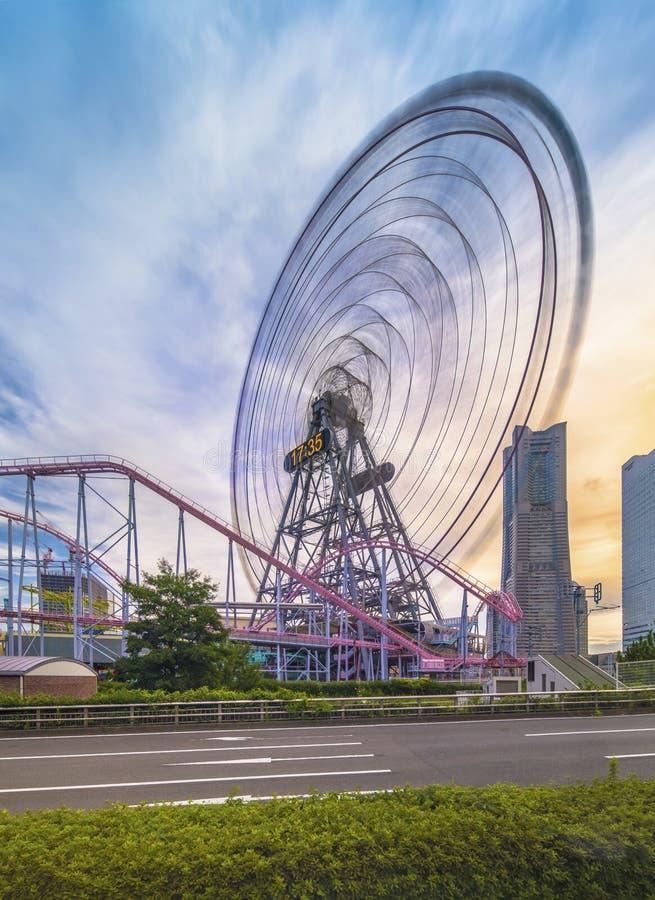 View from Kokusai bridge of Cosmo Clock 21 Big Wheel at Cosmo World Theme Park, overlooking the Diving Coaster Vanish in. The Minato Mirai district of Yokohama royalty free stock image