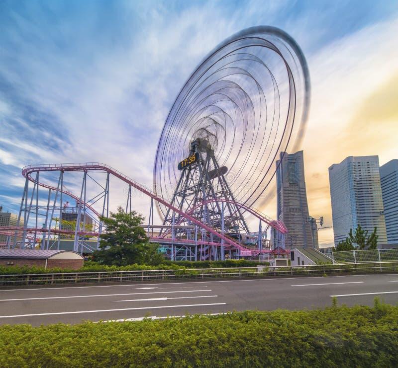 View from Kokusai bridge of Cosmo Clock 21 Big Wheel at Cosmo World Theme Park, overlooking the Diving Coaster Vanish in. The Minato Mirai district of Yokohama royalty free stock photos