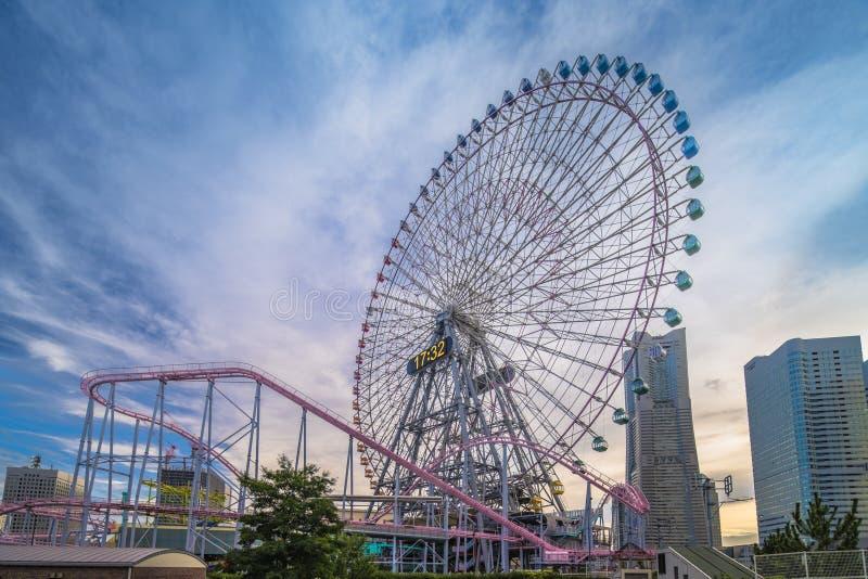 View from Kokusai bridge of Cosmo Clock 21 Big Wheel at Cosmo World Theme Park, overlooking the Diving Coaster Vanish in. The Minato Mirai district of Yokohama stock image