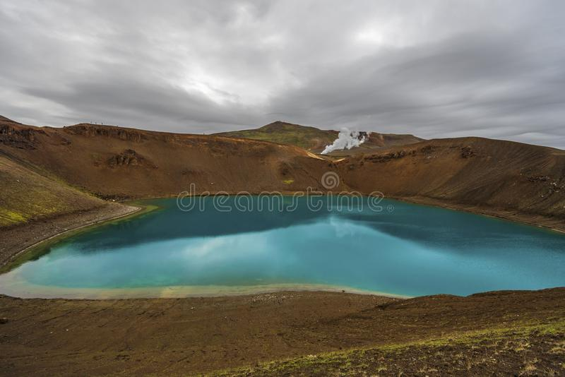 View at Krafla volcanic crater and Viti lake in northern Iceland, vapor of geothermal power plant unit is at background stock photos