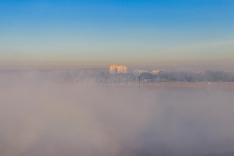 View on Kremenchug city and Dnieper river, Ukraine in fog at autumn. View on the Kremenchug city and Dnieper river, Ukraine in fog at autumn stock images