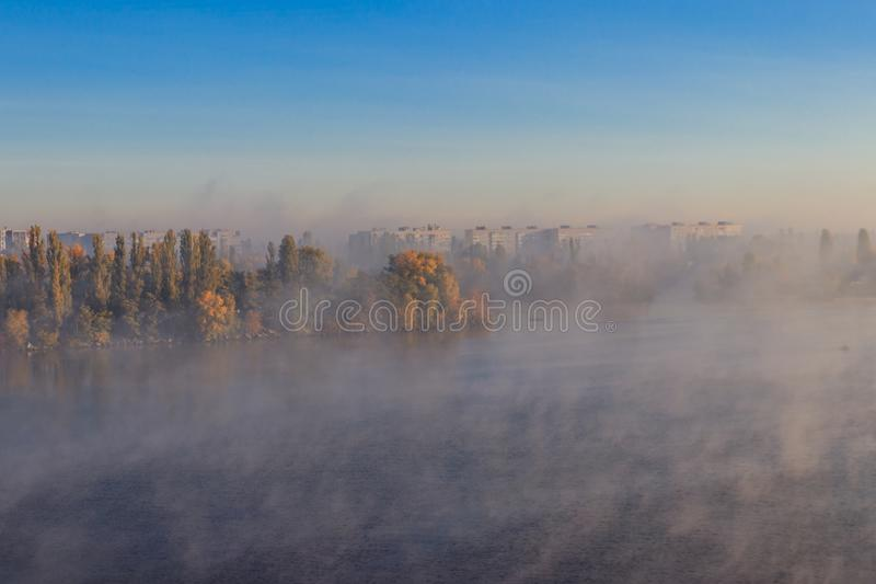 View on Kremenchug city and Dnieper river, Ukraine in fog at autumn. View on the Kremenchug city and Dnieper river, Ukraine in fog at autumn stock photos