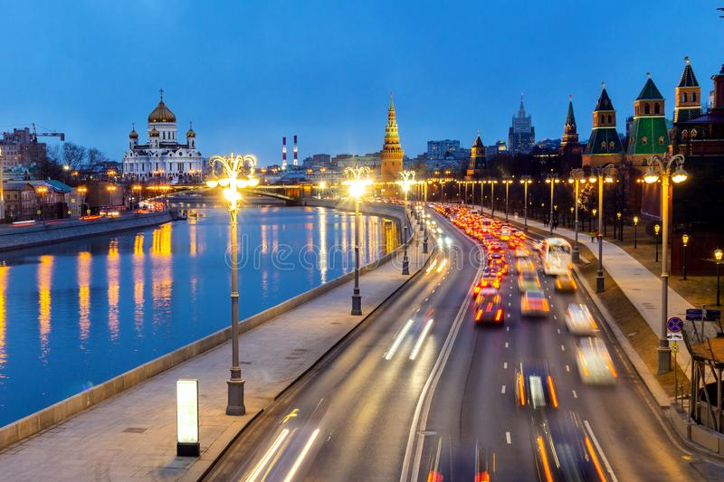 View of the Kremlin embankment from Moskvoretsky bridge to the Cathedral of Christ the Saviour and the water tower in stock photo