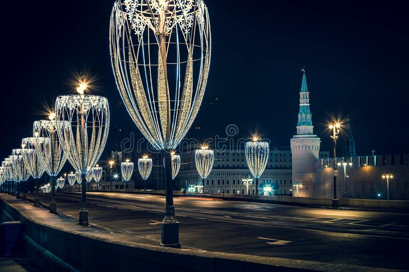 View of Kremlin tower on the Red Square from embankment with Chrismas illumination in Moscow at night stock photos