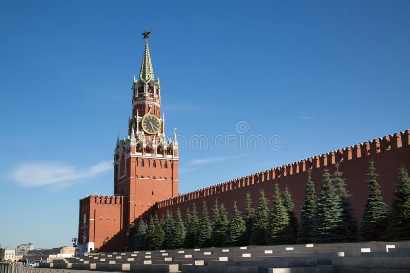 View of the Kremlin wall and the Spasskaya tower of the Moscow Kremlin on a clear Sunny day. royalty free stock photo