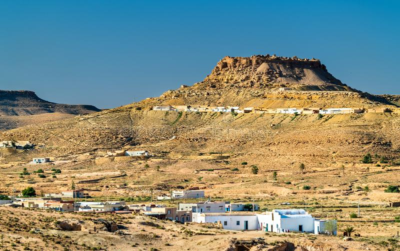 View of Ksar Beni Barka, a hilltop-located berber village at Tataouine, South Tunisia stock images