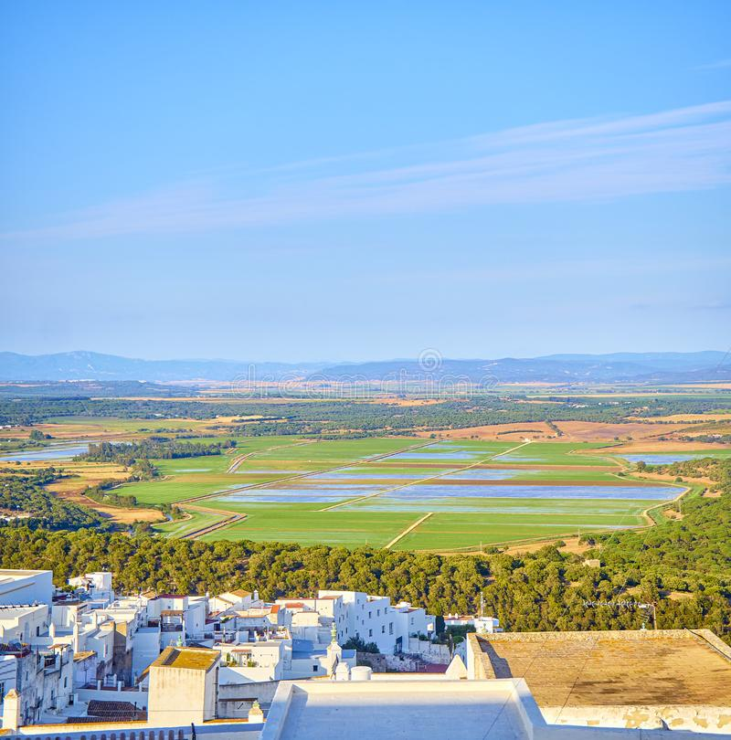 Vejer de la Frontera downtown. Cadiz province, Andalusia, Spain. A view of the La Janda county with the Marshes of Barbate river. View from the La Corredera royalty free stock images