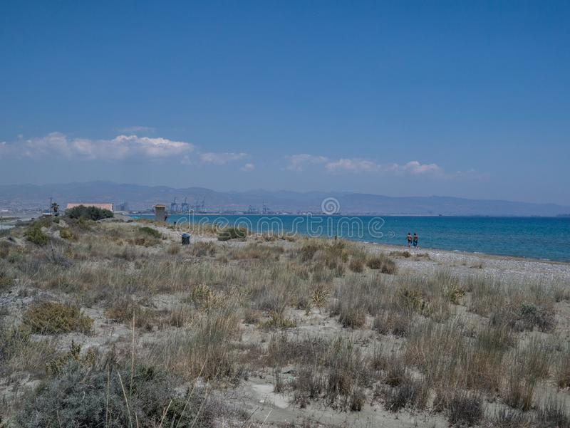 View of Lady`s Mile looking towards the industrial port of Limassol royalty free stock images