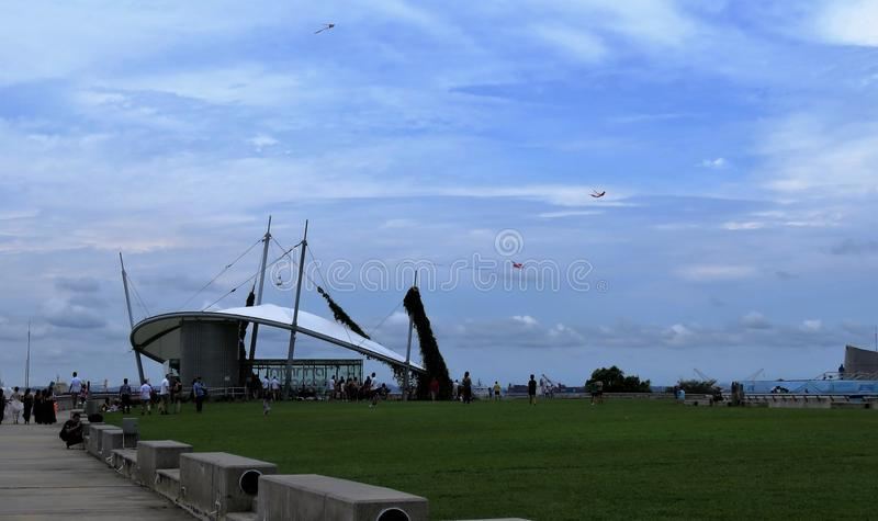 View of lagoon sea and buildings and kites royalty free stock image
