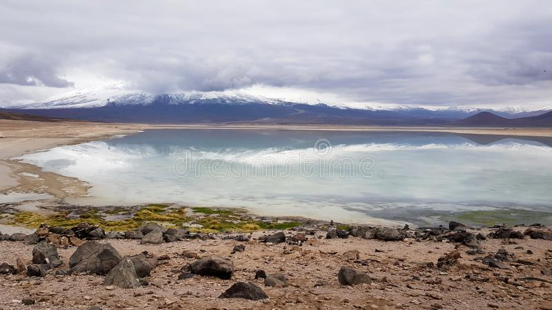 View of the Laguna Blanca and the peaks of the Andes royalty free stock image