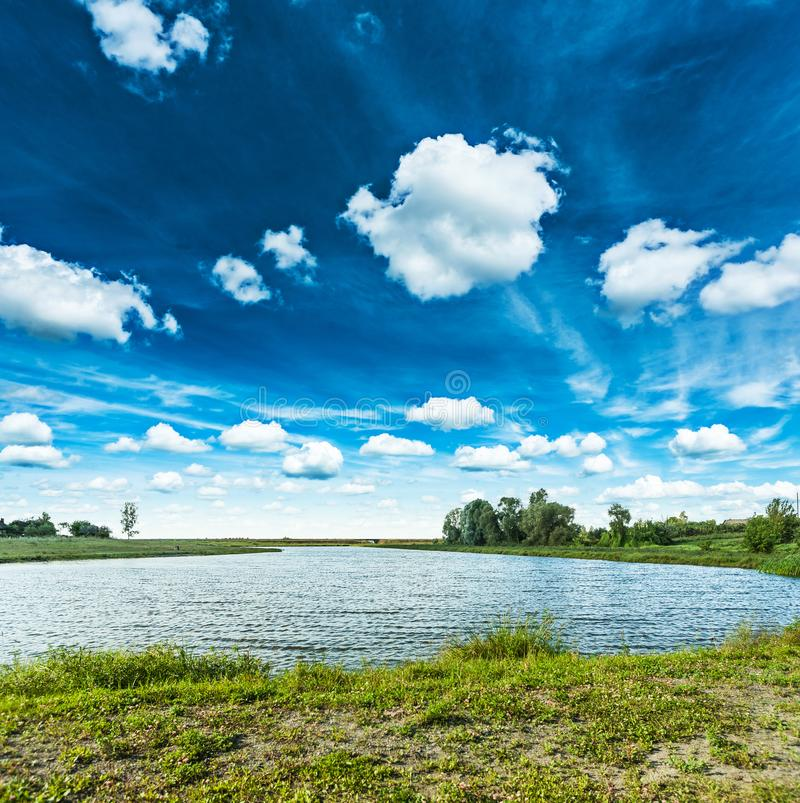 View on lake and beautiful cloudy skyes royalty free stock images
