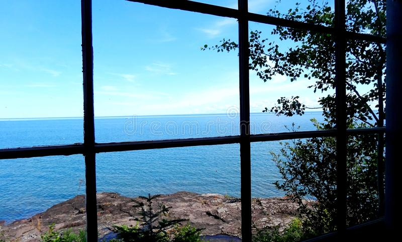 View of the lake through the cabin window royalty free stock photography