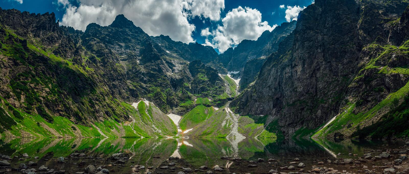 View on the lake called black pond under high and rocky mountains. stock images