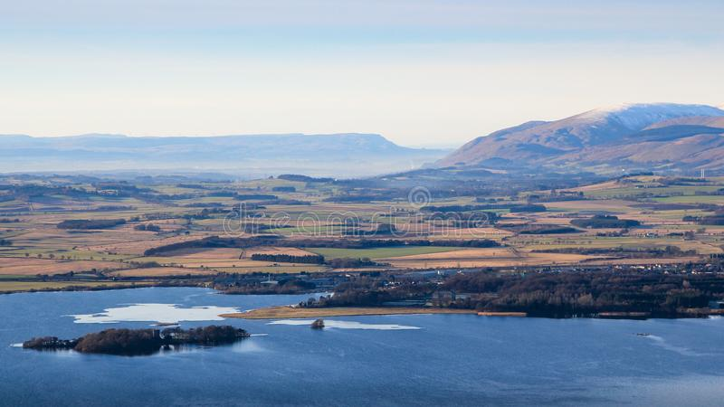 View West from the Lomond Hills towards Kinross, Loch Leven, and distant Ochil hills, Fife, Scotland royalty free stock photo