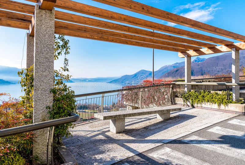 View of Lake Maggiore from the terrace with bench, Luino, Italy. View of Lake Maggiore from the terrace with bench, Luino, province of Varese, Italy royalty free stock photography
