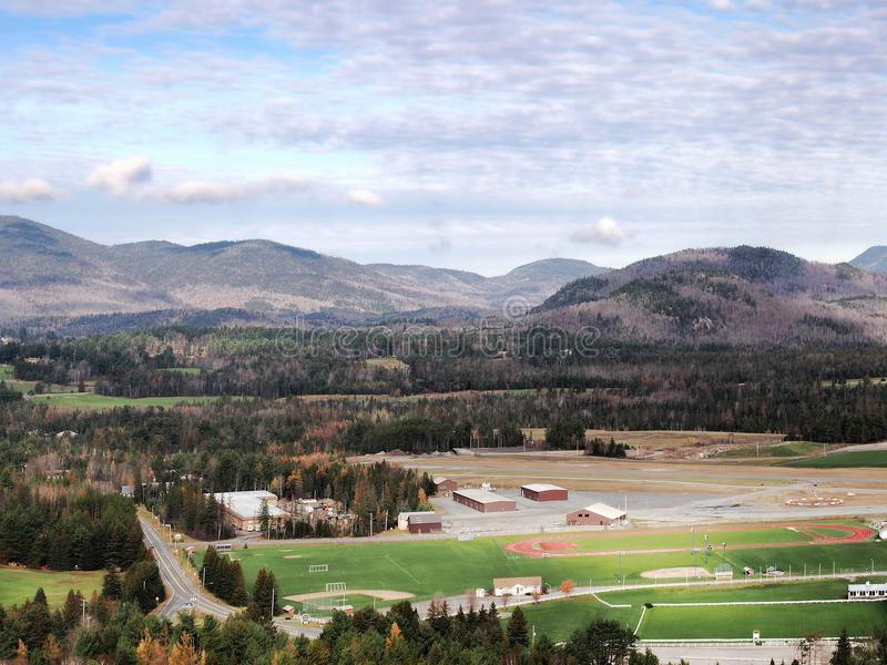 View of Lake Placid suburbs. Aerial view of Lake Placid suburbs and mountain range royalty free stock photos